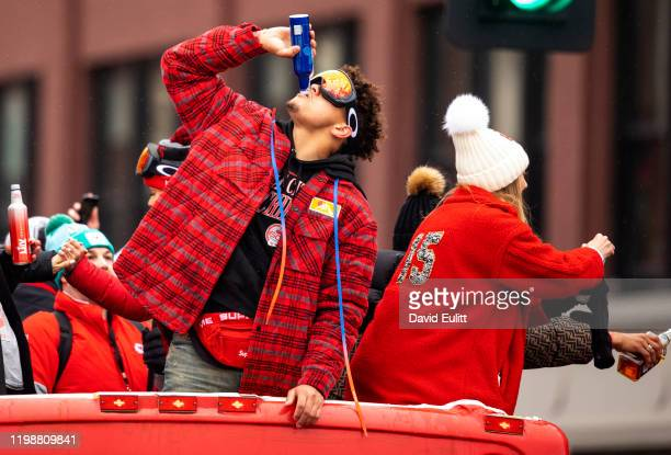 Patrick Mahomes of the Kansas City Chiefs celebrates atop one of the team buses on February 5, 2020 in Kansas City, Missouri during the citys...