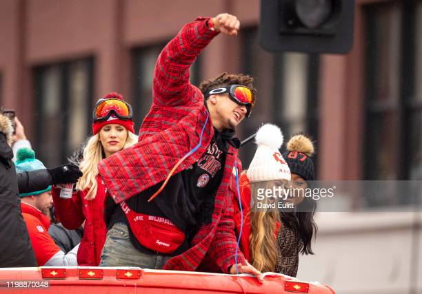 Patrick Mahomes of the Kansas City Chiefs celebrates atop one of the team buses on February 5 2020 in Kansas City Missouri during the citys...