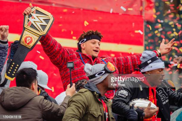 Patrick Mahomes of the Kansas City Chiefs celebrates with a heavy weight title belt during the Kansas City Chiefs Victory Parade on February 5 2020...