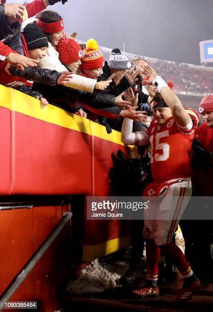 Patrick Mahomes of the Kansas City Chiefs celebrates with fans after the Chiefs defeated the the Indianapolis Colts to win the AFC Divisional round...