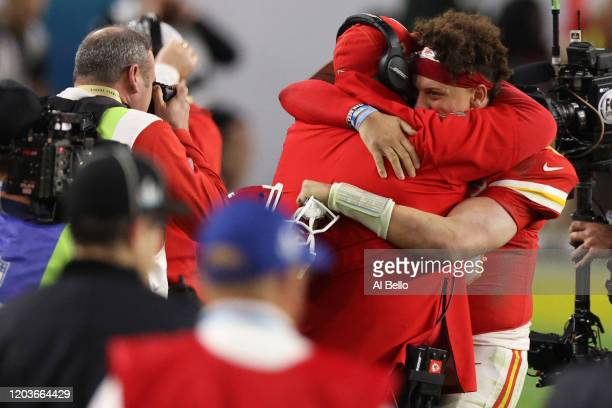 Patrick Mahomes of the Kansas City Chiefs celebrates with head coach Andy Reid after defeating the San Francisco 49ers in Super Bowl LIV at Hard Rock...