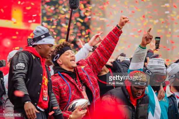 Patrick Mahomes of the Kansas City Chiefs celebrates with the Super Bowl MVP trophy during the Kansas City Chiefs Victory Parade on February 5 2020...