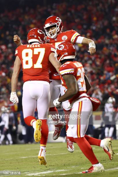 Patrick Mahomes of the Kansas City Chiefs celebrates with Travis Kelce after scoring a touchdown in the third quarter against the New England...