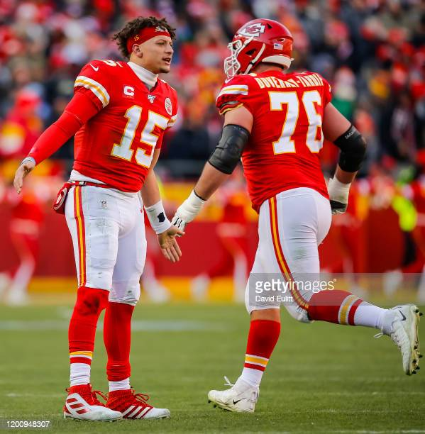 Patrick Mahomes of the Kansas City Chiefs congratulates Laurent DuvernayTardif of the Kansas City Chiefs after a first quarter touchdown in the AFC...