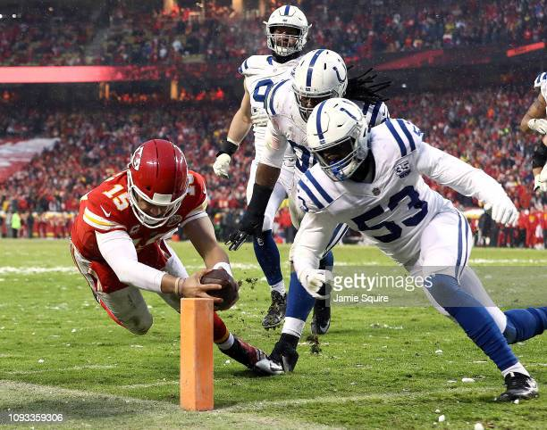 Patrick Mahomes of the Kansas City Chiefs dives for the endzone for a touchdown as Darius Leonard of the Indianapolis Colts defends during the AFC...