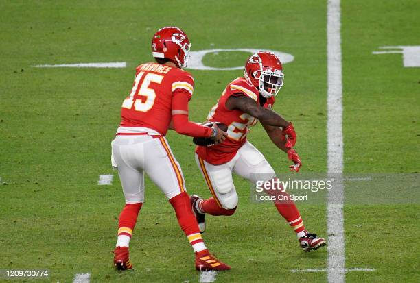 Patrick Mahomes of the Kansas City Chiefs fakes the handoff to Damien Williams against the San Francisco 49ers in Super Bowl LIV at Hard Rock Stadium...