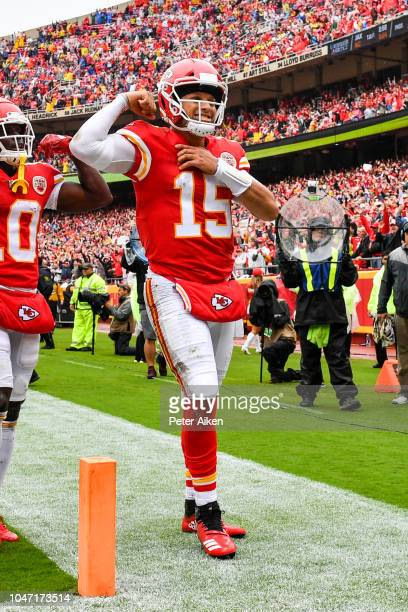 Patrick Mahomes of the Kansas City Chiefs flexes his muscle after scoring a rushing touchdown during the first quarter of the game against the...