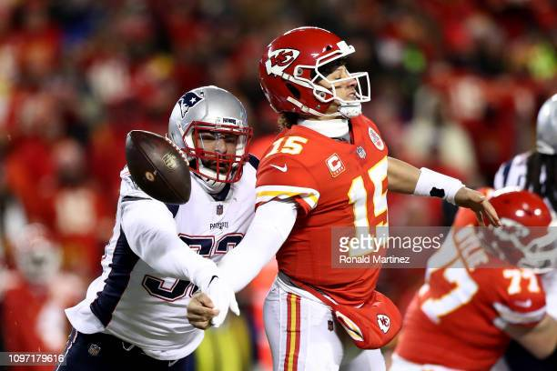 Patrick Mahomes of the Kansas City Chiefs fumbles the ball as he is hit by Kyle Van Noy of the New England Patriots in the second quarter during the...