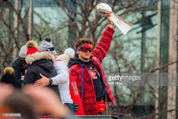 Patrick Mahomes of the Kansas City Chiefs hoists the Super Bowl Trophy during the Kansas City Super Bowl parade on February 5 2020 in Kansas City...