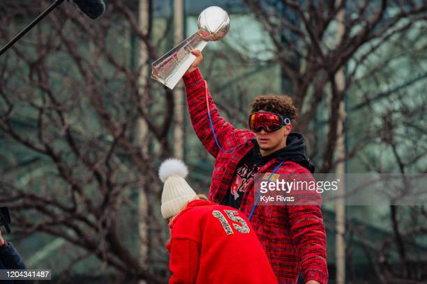 Patrick Mahomes of the Kansas City Chiefs hoists the Vince Lombardi Trophy during the Kansas City Chiefs Victory Parade on February 5 2020 in Kansas...