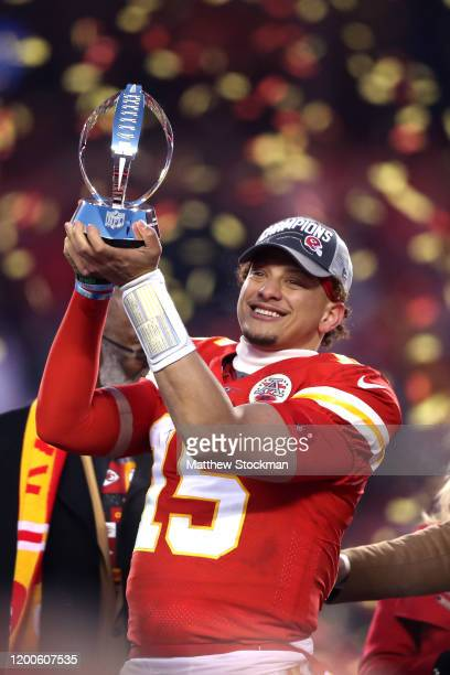 Patrick Mahomes of the Kansas City Chiefs holds up the Lamar Hunt trophy after defeating the Tennessee Titans in the AFC Championship Game at...
