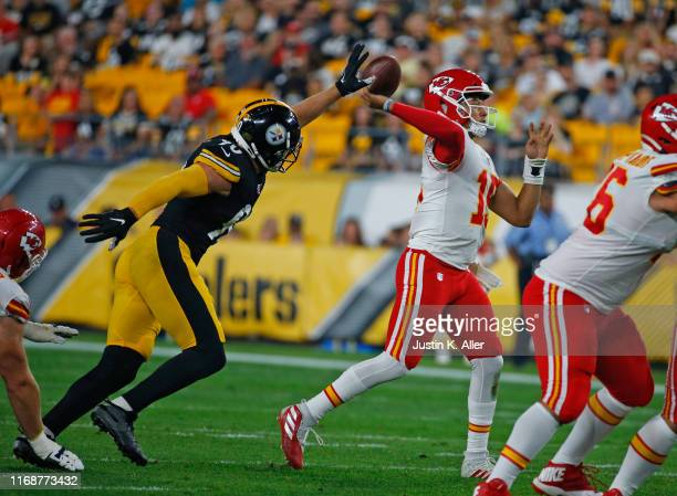 Patrick Mahomes of the Kansas City Chiefs in action during a preseason game against TJ Watt of the Pittsburgh Steelers on August 17 2019 at Heinz...
