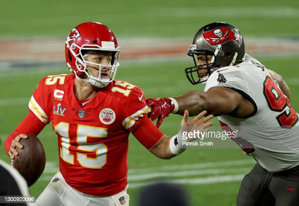Patrick Mahomes of the Kansas City Chiefs is chased by Ndamukong Suh of the Tampa Bay Buccaneers during the fourth quarter in Super Bowl LV at...