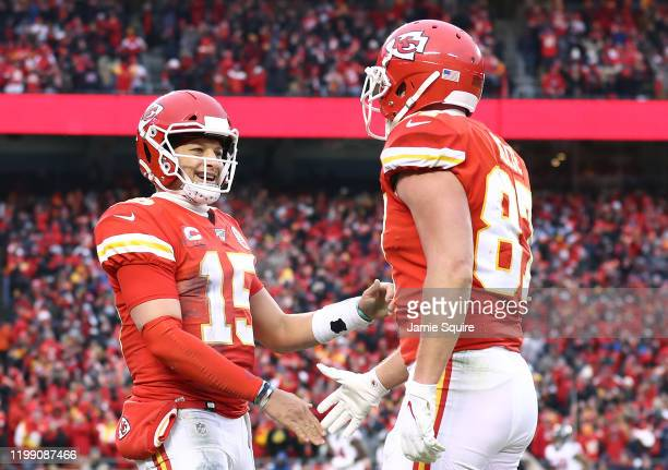Patrick Mahomes of the Kansas City Chiefs is congratulated by his teammate Travis Kelce after a third quarter touchdown against the Houston Texans in...