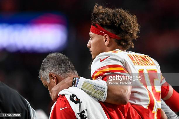Patrick Mahomes of the Kansas City Chiefs is helped off the field by trainers after sustaining an injury in the second quarter of a game against the...