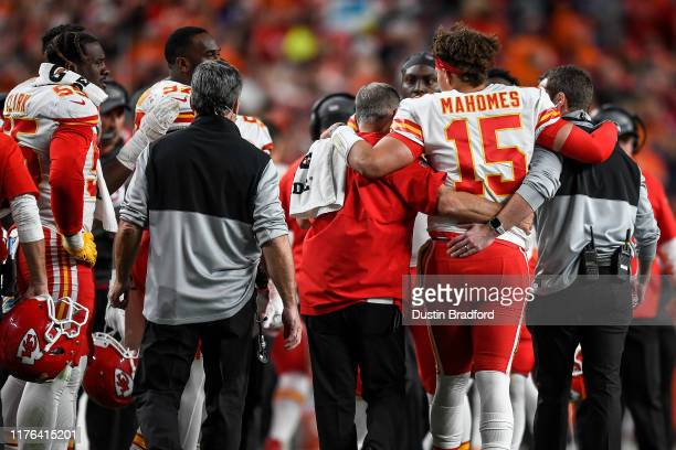 Patrick Mahomes of the Kansas City Chiefs is helped off the field after sustaining an injury in the second quarter of a game against the Denver...