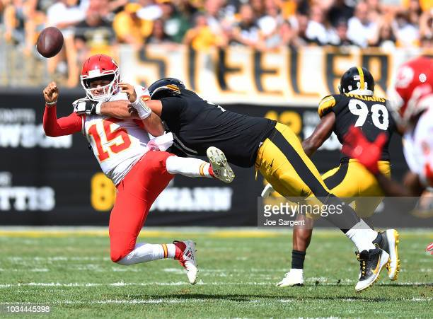Patrick Mahomes of the Kansas City Chiefs is hit as he throws by Cameron Heyward of the Pittsburgh Steelers in the first half during the game at...