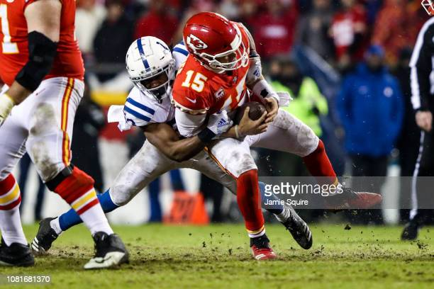 Patrick Mahomes of the Kansas City Chiefs is hit by Kenny Moore of the Indianapolis Colts during the fourth quarter of the AFC Divisional Round...