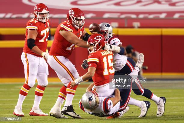 Patrick Mahomes of the Kansas City Chiefs is sacked by Chase Winovich of the New England Patriots during the first half at Arrowhead Stadium on...