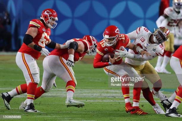 Patrick Mahomes of the Kansas City Chiefs is sacked by DeForest Buckner of the San Francisco 49ers during the third quarter in Super Bowl LIV at Hard...