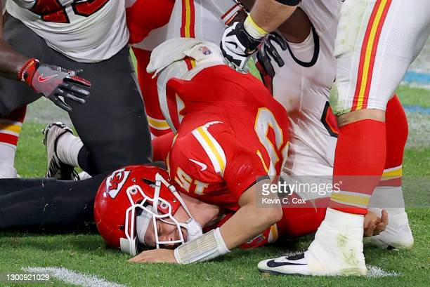 Patrick Mahomes of the Kansas City Chiefs is tackled by Devin White and Jason Pierre-Paul of the Tampa Bay Buccaneers in the fourth quarter in Super...