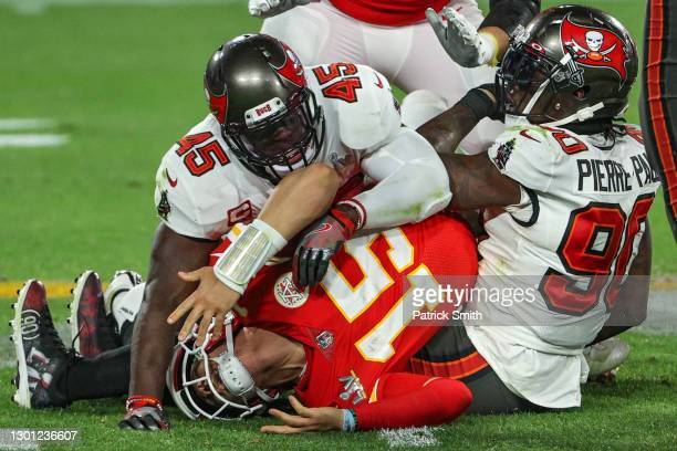 Patrick Mahomes of the Kansas City Chiefs is tackled by Jason Pierre-Paul and Devin White of the Tampa Bay Buccaneers in the fourth quarter during...