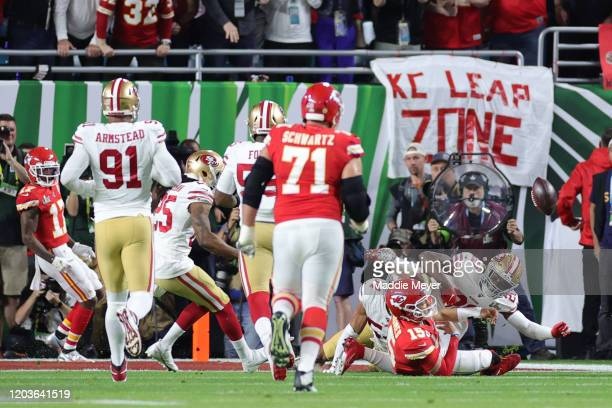 Patrick Mahomes of the Kansas City Chiefs is tackled by Jimmie Ward of the San Francisco 49ers during the first quarter in Super Bowl LIV at Hard...
