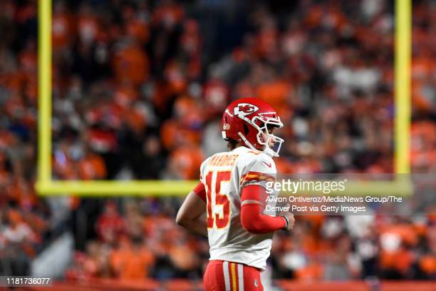 Patrick Mahomes of the Kansas City Chiefs jogs off the field after a failed third-down attempt against the Denver Broncos during the first quarter on...