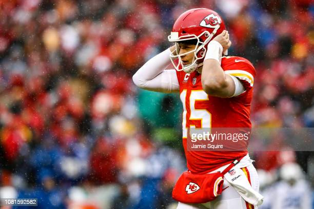 Patrick Mahomes of the Kansas City Chiefs listens to a play being called in against the Indianapolis Colts during the first quarter of the AFC...
