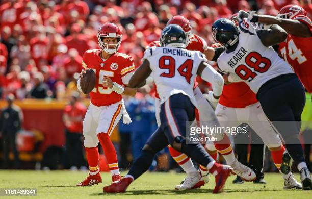 Patrick Mahomes of the Kansas City Chiefs looks downfield for an open receiver against the Houston Texans at Arrowhead Stadium on October 13 2019 in...