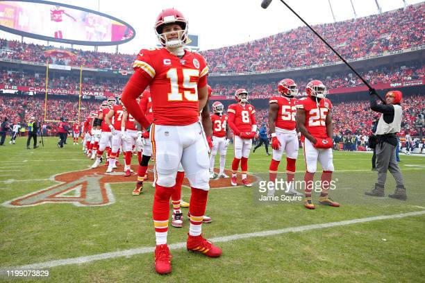 Patrick Mahomes of the Kansas City Chiefs looks on prior to the AFC Divisional playoff game against the Houston Texans at Arrowhead Stadium on...
