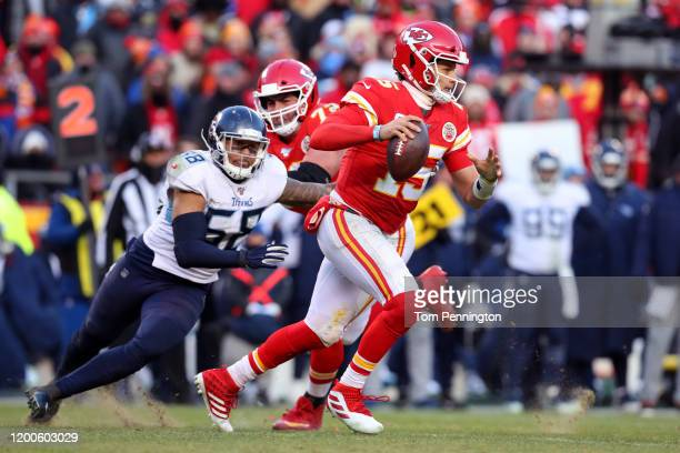 Patrick Mahomes of the Kansas City Chiefs looks to pass in the fourth quarter against the Tennessee Titans in the AFC Championship Game at Arrowhead...