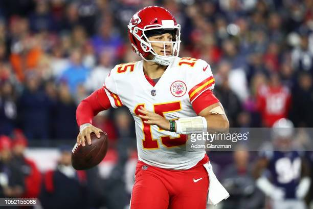Patrick Mahomes of the Kansas City Chiefs looks to pass in the second quarter of a game against the New England Patriots at Gillette Stadium on...