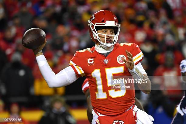 Patrick Mahomes of the Kansas City Chiefs looks to pass in the second half against the New England Patriots during the AFC Championship Game at...
