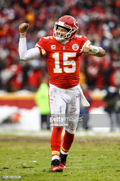 Patrick Mahomes of the Kansas City Chiefs points to the sidelines in celebration after throwing a touchdown against the Kansas City Chiefs during the...