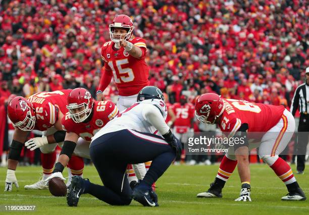 Patrick Mahomes of the Kansas City Chiefs prepares to snap the ball against the Houston Texans during the second quarter in the AFC Divisional...