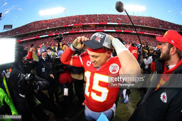 Patrick Mahomes of the Kansas City Chiefs puts on a championship hat after defeating the Tennessee Titans in the AFC Championship Game at Arrowhead...