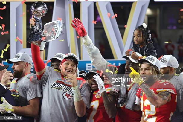 Patrick Mahomes of the Kansas City Chiefs raises the Vince Lombardi Trophy after defeating the San Francisco 49ers 3120 in Super Bowl LIV at Hard...