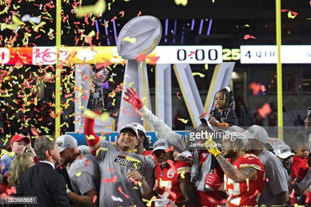 Patrick Mahomes of the Kansas City Chiefs raises the Vince Lombardi Trophy after defeating the San Francisco 49ers 31-20 in Super Bowl LIV at Hard...