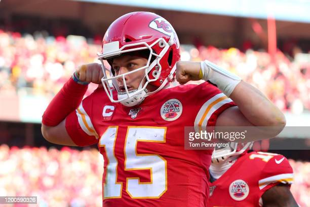 Patrick Mahomes of the Kansas City Chiefs reacts after running for a 27 yard touchdown in the second quarter against the Tennessee Titans in the AFC...