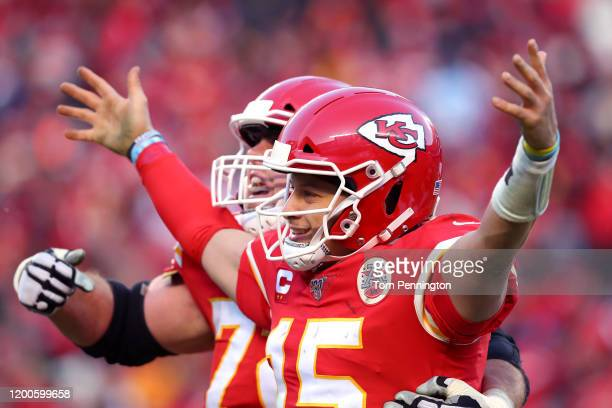 Patrick Mahomes of the Kansas City Chiefs reacts with teammate Eric Fisher after a fourth quarter touchdown pass against the Tennessee Titans in the...