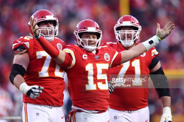 Patrick Mahomes of the Kansas City Chiefs reacts with teammates Eric Fisher and Mitchell Schwartz after a fourth quarter touchdown pass against the...