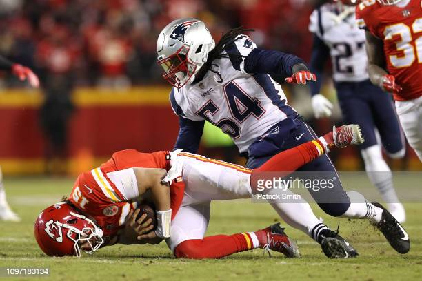 Patrick Mahomes of the Kansas City Chiefs recovers the ball after fumbling in the second quarter against the New England Patriots during the AFC...