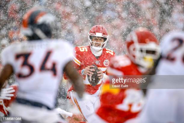 Patrick Mahomes of the Kansas City Chiefs rolls out during a third quarter touchdown throw in the third quarter against the Denver Broncos at...