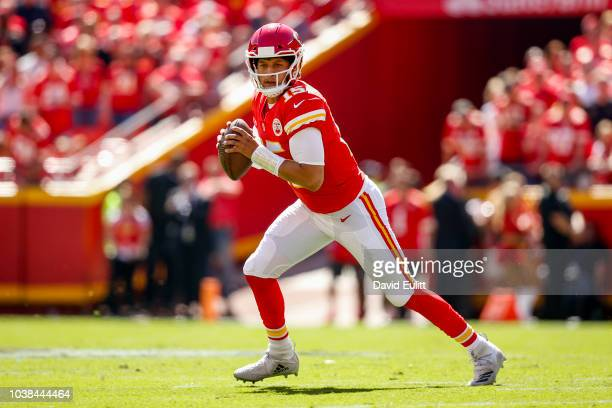 Patrick Mahomes of the Kansas City Chiefs rolls out of the pocket during the first quarter of the game against the San Francisco 49ers at Arrowhead...