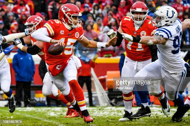 Patrick Mahomes of the Kansas City Chiefs rolls out of the pocket with Margus Hunt of the Indianapolis Colts in chase during the first quarter of the...