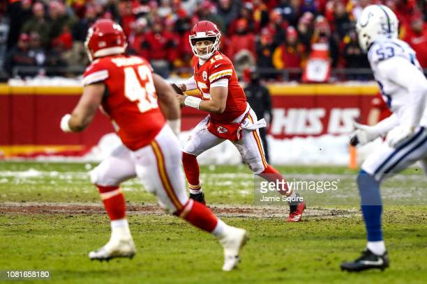 Patrick Mahomes of the Kansas City Chiefs rolls out of the pocket against the Indianapolis Colts during the first half of the AFC Divisional Round...
