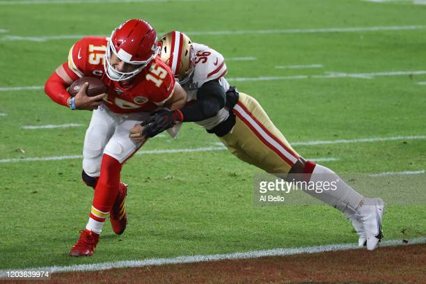 Patrick Mahomes of the Kansas City Chiefs runs for a touchdown against the San Francisco 49ers during the first quarter in Super Bowl LIV at Hard...