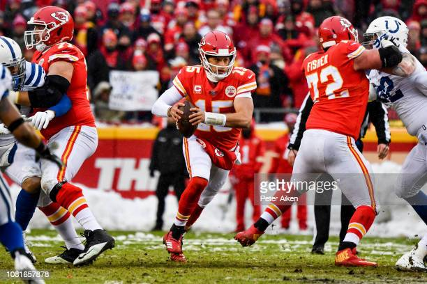 Patrick Mahomes of the Kansas City Chiefs runs out of the pocket against the Indianapolis Colts during the first quarter of the AFC Divisional Round...