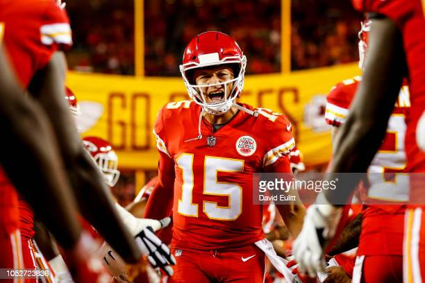 Patrick Mahomes of the Kansas City Chiefs runs through high fives from teammates during pre game introductions prior to the game against the...